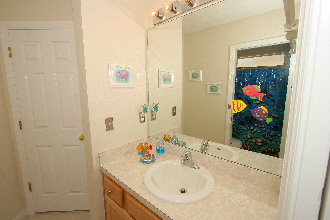 Bathroom on The Adjoining Ocean Themed Bathroom Is Shared Between The Cowboy And